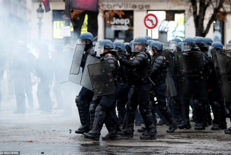 6584962-6424117-A_water_cannon_and_rounds_of_teargas_were_used_by_riot_police_ag-a-13_1543138657233