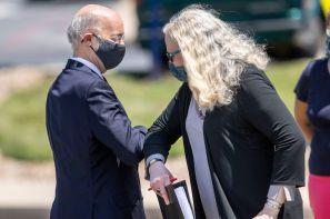 Pa. Gov. Tom Wolf greets Secretary of Health Dr. Rachel Levine with an elbow bump