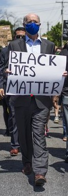 The white guy Tom with the blm sign