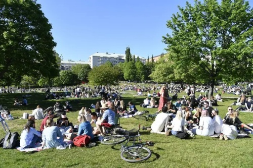 People sit in Tantolunden park in Stockholm on May 30, 2020, during the coronavirus pandemic.